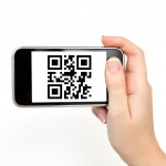 Young Woman Holding a Phone with a QR Code